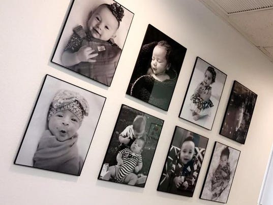 636439525282099678-Baby-pictures-adorn-Hope-Center-wall.jpg