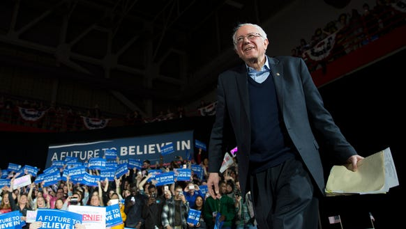 Bernie Sanders arrives for a campaign rally in Iowa