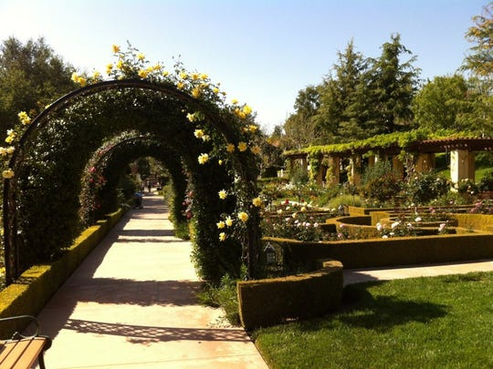 STAR FILE PHOTO Climbing roses cover the archways in the English perennial and rose gardens at Gardens of the World in Thousand Oaks.
