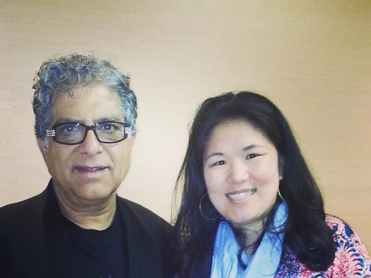 "Birmingham author Kristin Meekhof with Dr. Deepak Chopra at a book launch in Detroit for his latest novel, ""The 13th Disciple."""