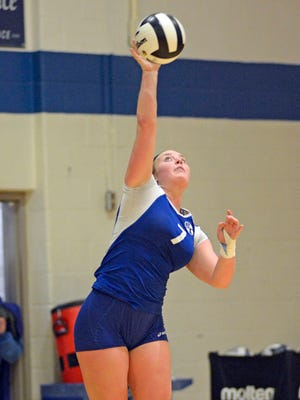 Anna Lubbers of Bishop Chatard competes in a volleyball regional against Cardinal Ritter.