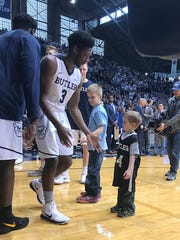 Deegan Scott (right) greets Kamar Baldwin during Butler