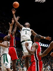 Michigan State's Joshua Langford, center, Xavier Tillman, far left, and Georgia's Tyree Crump, left, reach for a rebound during the first half of MSU's 80-68 exhibition win over Georgia on Sunday in Grand Rapids.