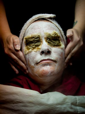 Esthetician Stacie Edie gives Kelly Shaw a European facial, which is a deep hydrating treatment with an avocado and acai berry mask Wednesday at A Day Away Spa in Port Huron.