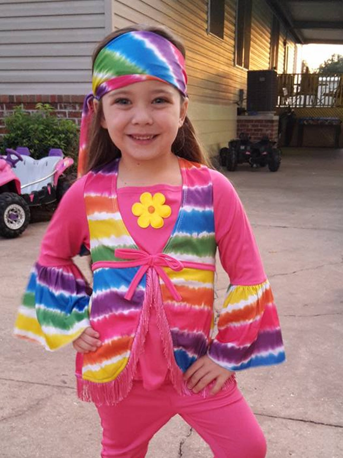 Jayla dressed as a hippie at Halloween.