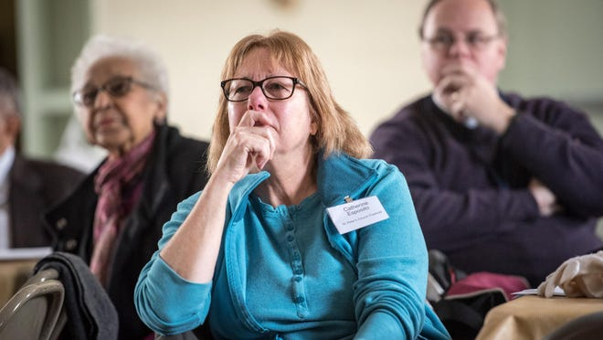 """Deacon Catherine Esposito of St. Peter's Episcopal Church, Freehold, listens to speakers. Trinity Institute's 45th National Theological Conference, """"Listen for a Change: Sacred Conversations for Racial Justice"""" was held at the Trinity Episcopal Church in Asbury Park, NJ, on Friday, January 22, 2016. /Russ DeSantis for the Asbury Park Press / Slug: ASB 0123 RACE DISCUSSION"""