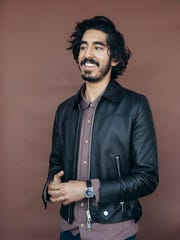 """In this Nov. 17, 2016 photo, Dev Patel poses for a portrait to promote his film, """"Lion,"""" in New York. Patel portrays Saroo Brierley, an Indian man who was lost as a five-year-old, adopted and raised by Australian parents, and who, 25 years later, used Google Earth to find his way home."""