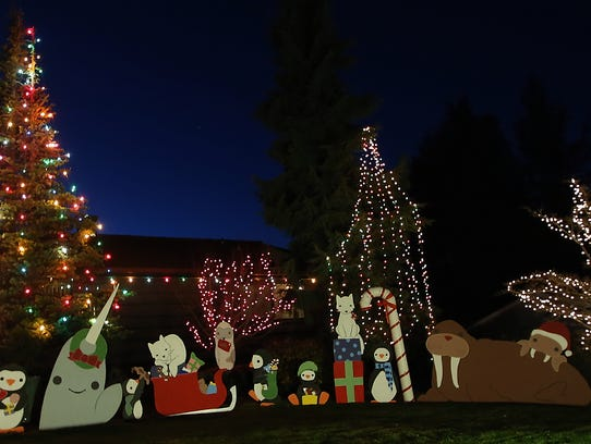 Christmas displays light up the Viewcrest Drive NE