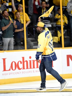 Titans' Delanie Walker waves to the fans before the Preds' game against the Ducks on Monday April 25, 2016 at Bridgestone Arena in Nashville, Tenn.