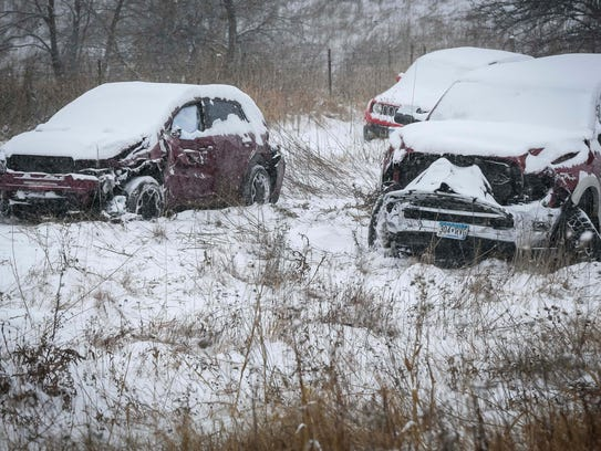 Officials work on cleaning up a 70-vehicle pileup on