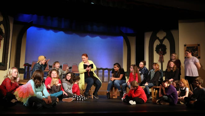 """Melissa Harvey is surrounded by children during a dress rehearsal of the Players Workshop of Burlington's Christmas comedy """"The Best Christmas Pageant Ever"""" Dec. 4, 2019 at the Players Workshop Theater on Grove Street in Burlington. The theater's 2020-21 season has been postponed until next year due to COVID-19 concerns, though performances may be presented online."""