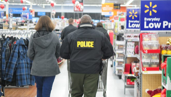 Cpl. Mance McCall of the Natural Resources Police during Shop With a Cop event in Fruitland.