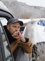 A motorist is stranded March 5, 2015, on Interstate