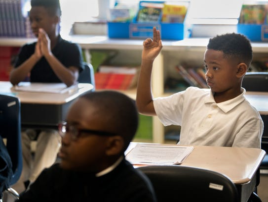 Felipe Williams raises his hand to ask a question of