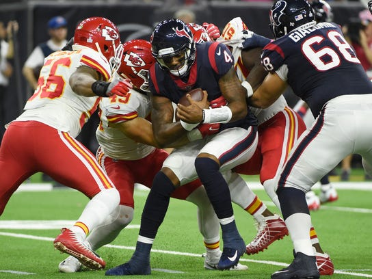 Houston Texans quarterback Deshaun Watson (4) is sacked by Kansas City Chiefs outside linebacker Frank Zombo (51) during the second half of an NFL football game Sunday, Oct. 8, 2017, in Houston. (AP Photo/Eric Christian Smith)