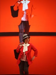 Dr. Sandra Dee models an outfit on the runway during the fashion show segment of last year's American Heart Association's West Tennessee Go Red For Women event at the Carl Perkins Civic Center.
