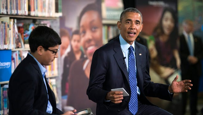 President Obama with student moderator Osman Yahya at Anacostia Library in Washington, D.C.