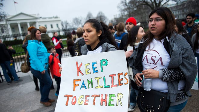 Immigrant activists march in front of the White House.