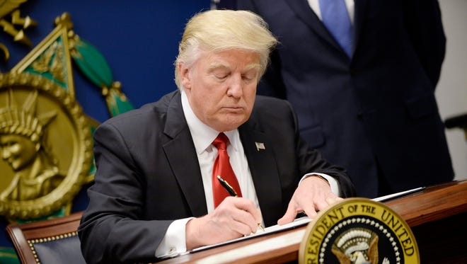 President Trump signs executive orders at the Pentagon on Jan. 27, 2017.