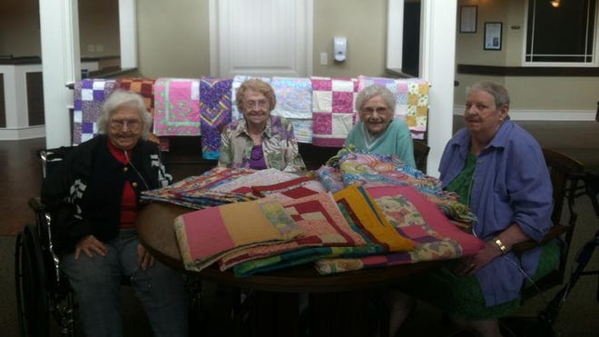 Residents from RiverLodge Assisted Living recently made baby blankets to sell at Twin Lakes Treasure Hunt. Proceeds benefitted the Pregnancy Resource Center. Shown with their work are (from left) Earlene Berning, Bonnie Turner, Margaret Drake and Gladys Manuel.