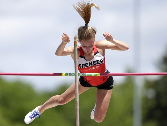 Johanna Ellfson, of Spencer, clears the bar during