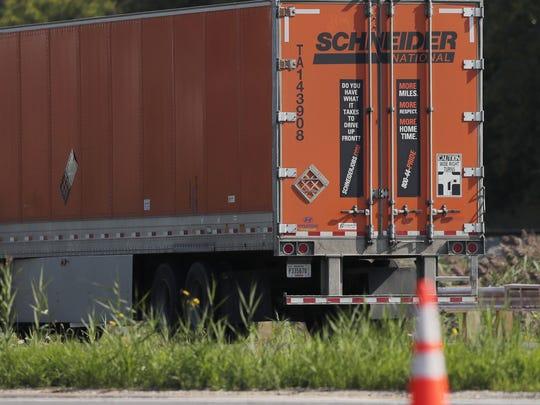 A Schneider truck drives down Ashland Avenue on Wednesday in Green Bay.