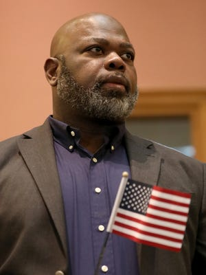 Carl Auguste, originally of Haiti, was among 26 people who became American citizens in Jersey City on Wednesday.