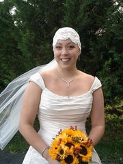 Amber Shaw poses on her wedding day in October 2014,