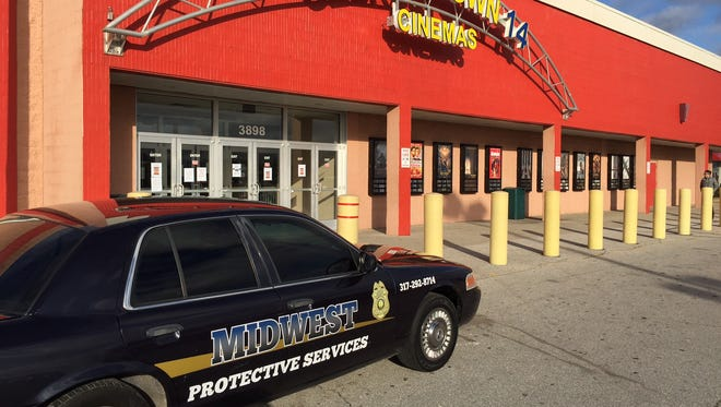 A security company car is parked in front of the Georgetown 14 Theaters, the only place in Indianapolis showing the movie The Interview.