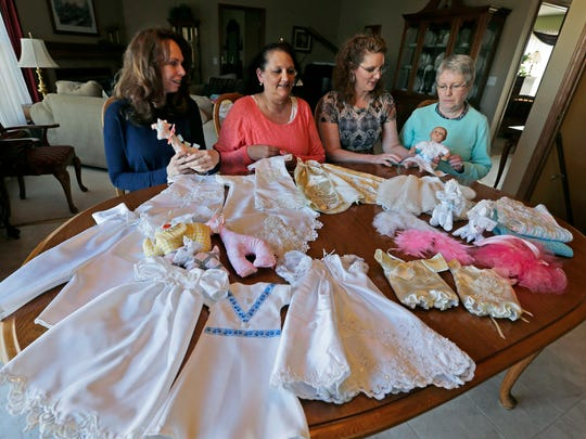From left, Susan Capozzi,  Dawn Meisinger, Terri Nowicki and Marge Allender participate in  a nonprofit, Sweet Send Aways, which provides infant-sized outfits made out of donated wedding gowns to Children's Hospital of Wisconsin.