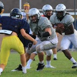 Isaac Emminger (right) will be a Plymouth mainstay on both sides of the ball in 2016.
