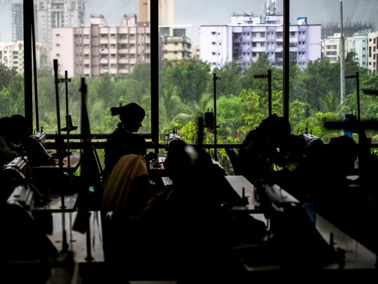 Former sexually exploited women sew while making handbags and other goods for The Aruna Project in Mumbai, India, on Wednesday, June 28, 2017. The Aruna Project offers former sexually exploited women a safe place of employment.