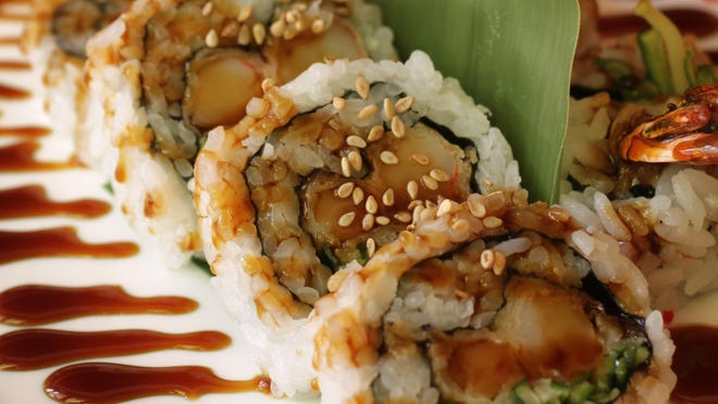 On the menu at Sura is sushi like this shrimp tempura roll. They also have Korean specialties.