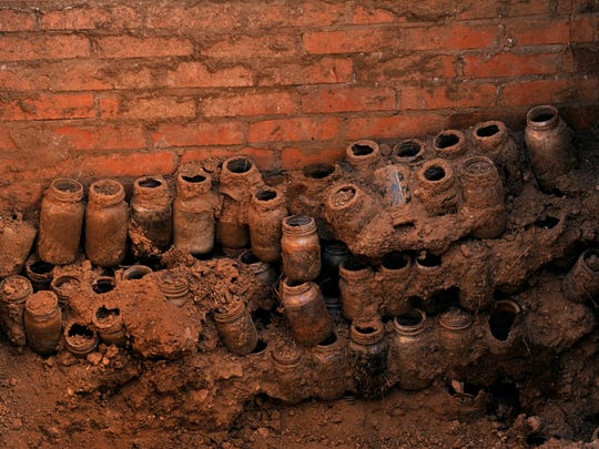 Mason jars are stacked against the wall of the storm cellar at the Robert E. Howard home in Cross Plains Tuesday. A team of National Park Service archaeologists spent a week excavating the site where the fantasy author lived until his death in 1936.