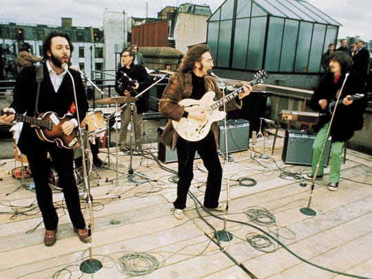 """The Beatles perform on the rooftop of Abbey Road studios on Jan. 30, 1969. The performance, part of the filming of the movie """"Let It Be,"""" was the band's last live performance."""