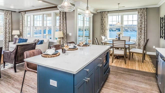 The Spinnaker model features a gourmet kitchen and lakefront views.