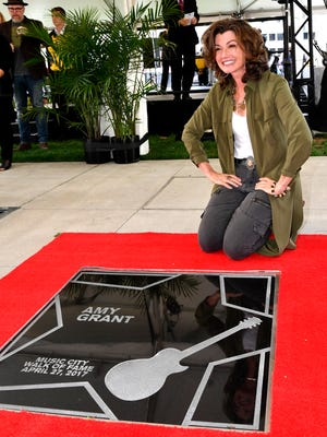 Grammy-winning artist Amy Grant receives her star on the Music City Walk of Fame during an induction ceremony Thursday, April 27, 2017, at Walk of Fame Park in Nashville.