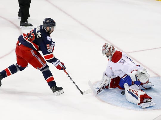 Montreal Canadiens goalie Carey Price (31) blocks a shot by Rangers center Mika Zibanejad (93) during the shootout in Tuesday's game in New York. The Canadiens won 3-2.