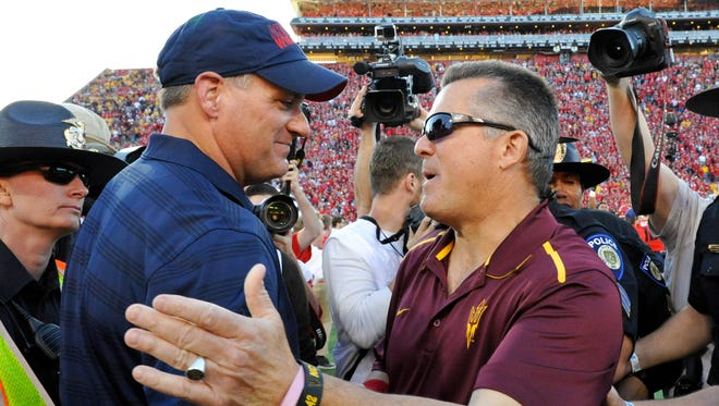 Nov 28, 2014: Arizona Wildcats head coach Rich Rodriguez and Arizona State Sun Devils head coach Todd Graham shake hands after the fourth quarter of the territorial cup at Arizona Stadium. The Wildcats won 42-35.