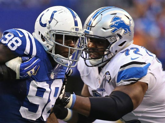 Colts linebacker Robert Mathis makes a move past Lions offensive lineman Laken Tomlinson during the Lions' 39-35 win in Week 1.