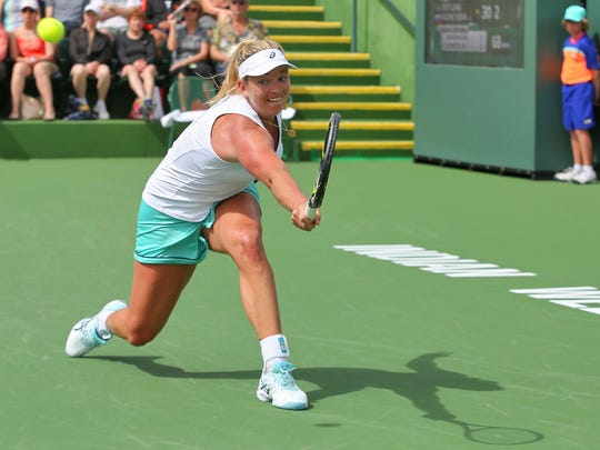 CoCo Vandeweghe hits a backhand during her match against Svetlana Kuznetsova at the Indian Wells Tennis Garden during the BNP Paribas Open, March 11, 2016.