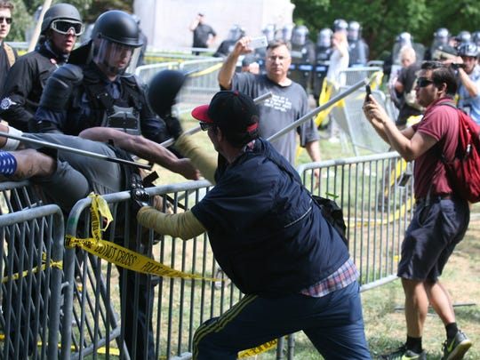 Alt Right demonstrators and counter protesters clash