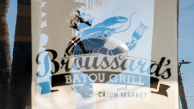 A Navarre water tower is reflected in the window at the new Broussard's Bayou Grill location in Navarre on Wednesday, October 18, 2017.  The restaurant is scheduled to open on Friday, October 20, 2017.