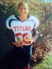 A young Langford with football awards.