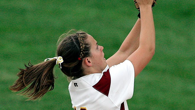 McCutcheon's Kelsey Rummel catches a fly ball during the state semifinal game in Carmel on Monday, June 9, 2008.