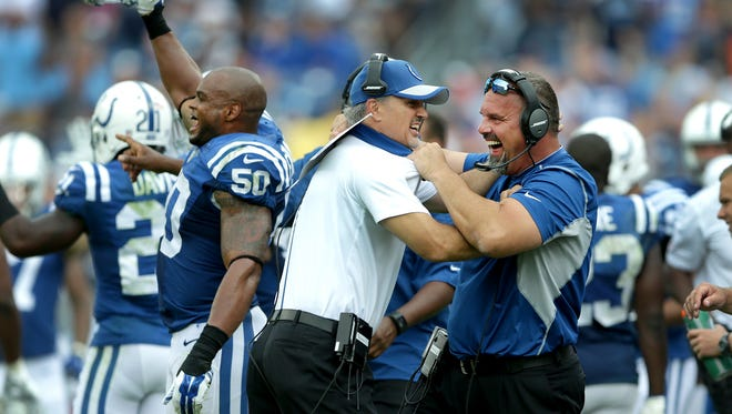Indianapolis Colts head coach Chuck Pagano and defensive coordinator Greg Manusky,right, begin to celebrates a win in the final minute of their game Sunday, September 27, 2015 at Nissan Stadium in Nashville TN.