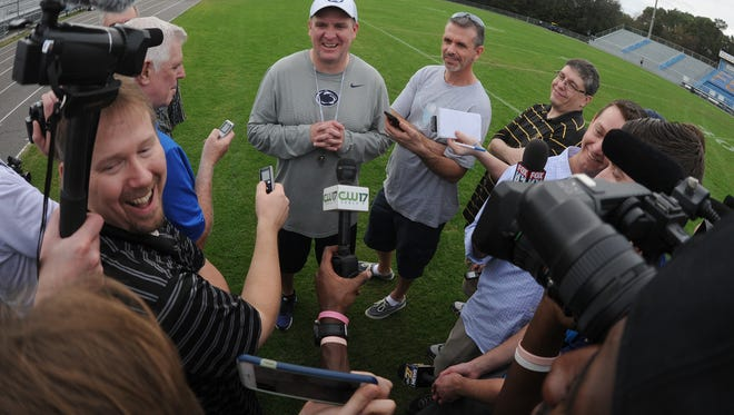 Bob Shoop, former defensive coordinator with Penn State, center, jokes with the media following a December 2015 practice leading up to the TaxSlayer Bowl at Fernandina Beach High School in Jacksonville, Fla.