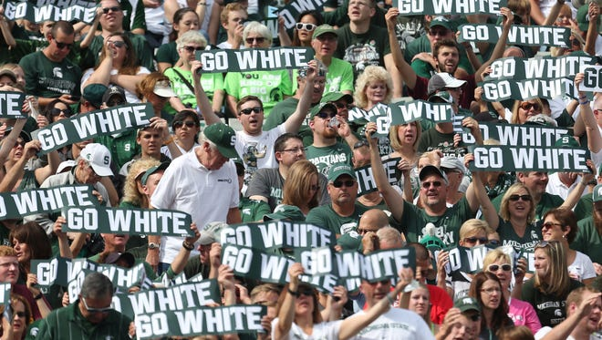 Michigan State fans cheer during second half action against Central Michigan on Sept. 26 at Spartan Stadium.
