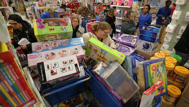 Early Black Friday shoppers were first into the Toys R Us in Castleton Thursday, November27, 2014, late afternoon to kickoff the holiday shopping season. Shoppers find bargains and roadblocks in the isles while shopping on Thanksgiving evening.