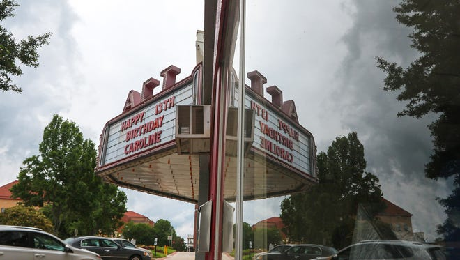 The Alverson Center Theater sign reflects in the window of its front office. Greenville-based Grace Church bought the downtown theater last week. It will serve as the church's Anderson campus.